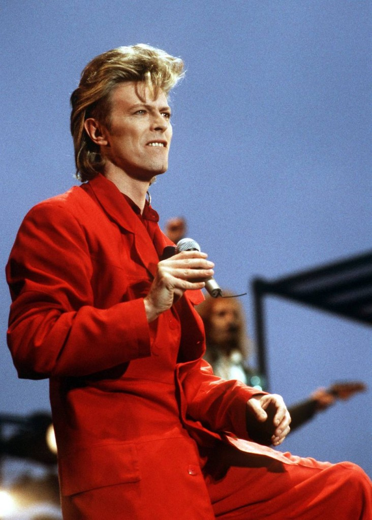 """(FILES) A photo taken on June 14, 1987 shows British rock music legend David Bowie performing on stage during an Open air concert in Hamburg, northern Germany. Bowie has died after a long battle with cancer, his official Twitter and Facebook accounts said on January 11, 2016. The iconic musician had turned 69 only on January 8, which coincided with the release of """"Blackstar"""", his 25th studio album. / AFP / DPA / Werner Baum / Germany OUT"""